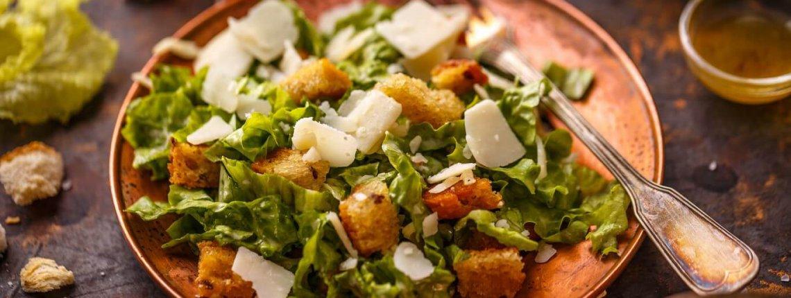 Caesar salad on vintage table. Healthy food style