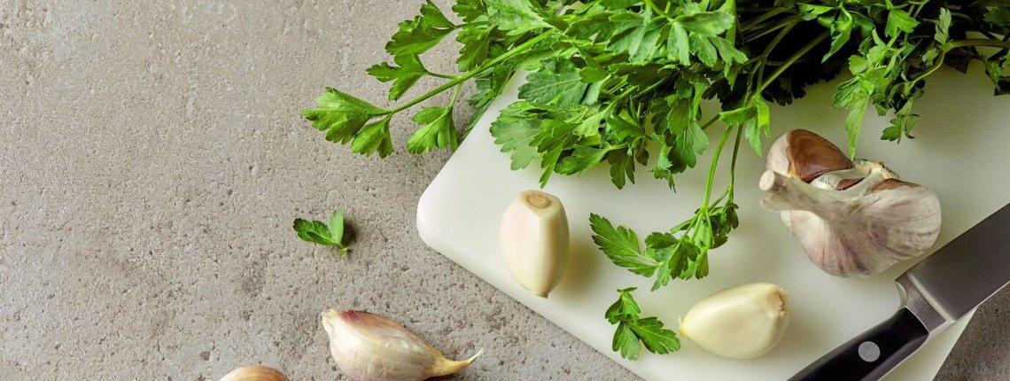 Parsley and garlic on cutting board